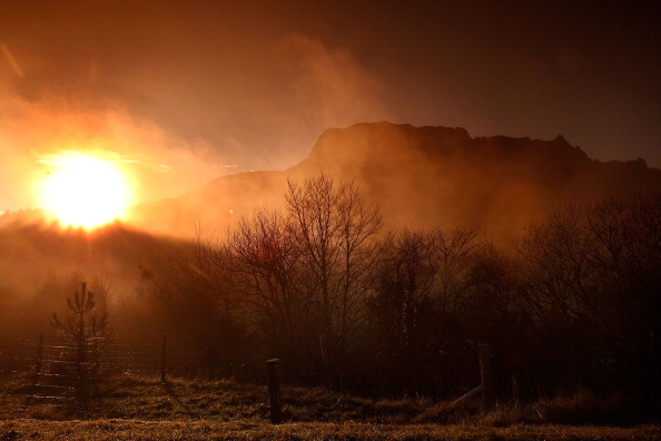 BUGARACH, FRANCE - DECEMBER 20: The sun rises over Bugarath, the small village in the foothills of the Pyrenees on December 20, 2012 in Bugarach, France. Miviludes, the French Government's dedicated sect watchdog, are investigating the likelihood of apocalyptic sect activity or ritualised suicides due to the  prophecy of an ancient Mayan calendar which also claims that Burgarach is the only place on Earth which will be saved from the apocalypse on the evening of December 21, 2012. (Photo by Patrick Aventurier/Getty Images)