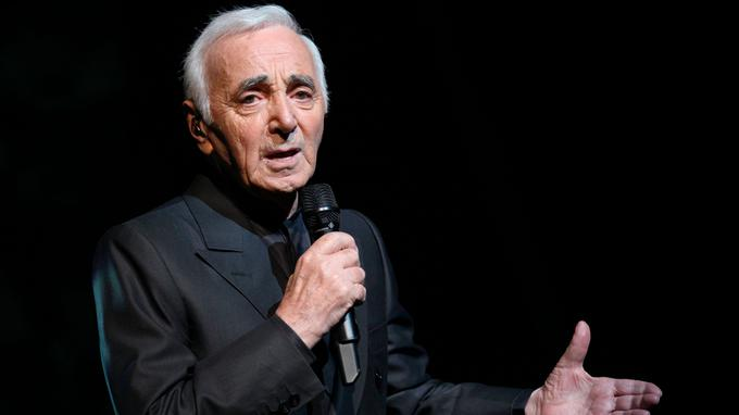 (FILES) In this file photo taken on September 7, 2011 French singer-songwriter Charles Aznavour performs on stage at the Olympia concert hall in Paris in Paris. - French singer/songwriter Charles Aznavour has died at the age of 94 it was announced on October 1, 2018. (Photo by PIERRE VERDY / AFP)